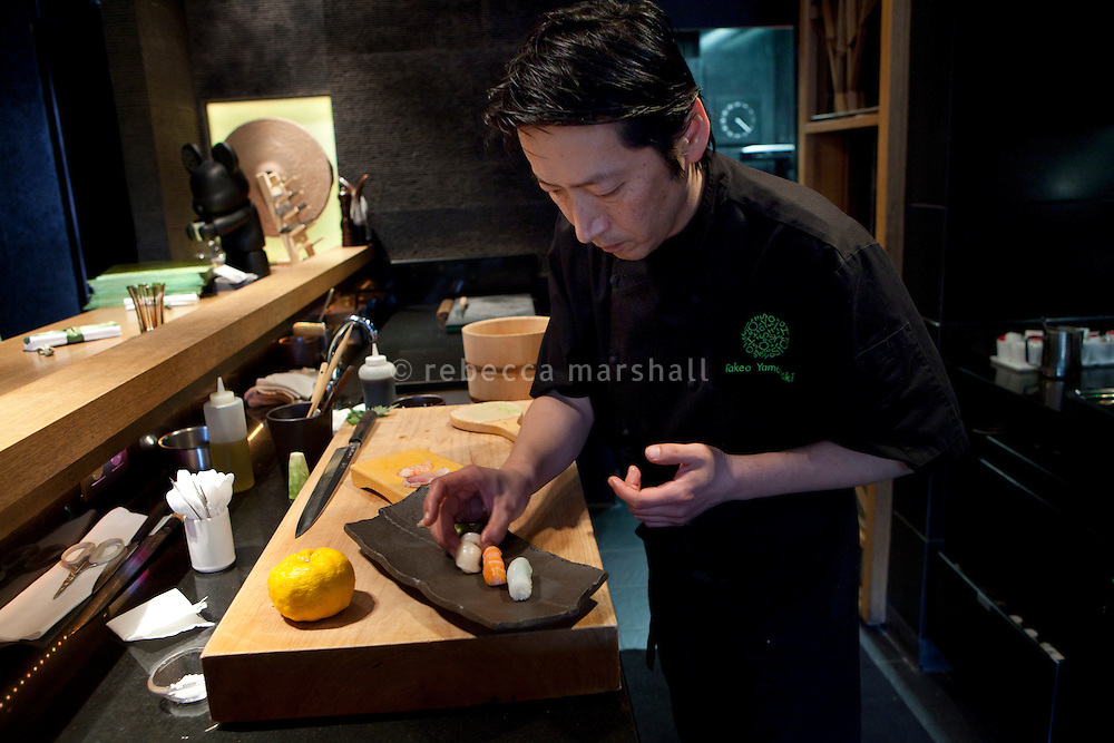 Head chef Takeo Yamazaki prepares sushi at Yoshi restaurant at the Metropole Hotel, Monaco, 23 March 2012