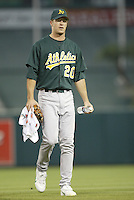 Mark Mulder of the Oakland Athletics prepares to pitch during a 2002 MLB season game against the Los Angeles Angels at Angel Stadium, in Anaheim, California. (Larry Goren/Four Seam Images)