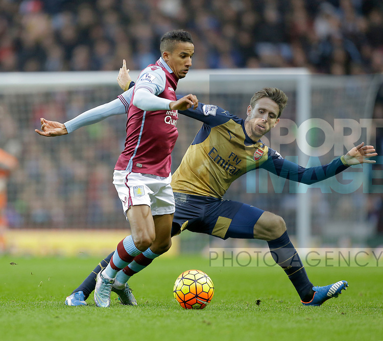 Scott Sinclair of Aston Villa competes with Nacho Monreal of Arsenal - Football - Barclays Premier League - Aston Villa vs Arsenal - Villa Park Birmingham - 13th December 2015 - Season 2015/2016 - Photo Malcolm Couzens/Sportimage