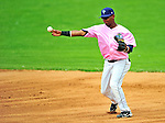"""18 July 2010: Vermont Lake Monsters infielder Hendry Jimenez in action against the Staten Island Yankees at Centennial Field in Burlington, Vermont. The Lake Monsters, dressed in their Breast Cancer Awareness """"Pinks"""", fell to the Yankees 9-5 in NY Penn League action. Mandatory Credit: Ed Wolfstein Photo"""
