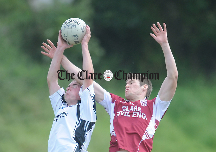 Ennistymon's David Murphy rises for a high ball with Mark Hallinan. Photograph by Declan Monaghan