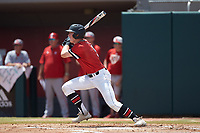 Charlie McConnell (9) of the Northeastern Huskies follows through on his swing against the North Carolina State Wolfpack at Doak Field at Dail Park on June 2, 2018 in Raleigh, North Carolina. The Wolfpack defeated the Huskies 9-2. (Brian Westerholt/Four Seam Images)