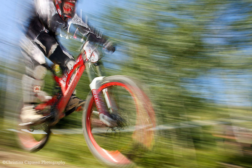 A biker competes in the downhill section of the Blast the Mass bike race at Snowmass Village.