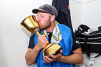 Picture by Alex Whitehead/SWpix.com - 12/09/2014 - Cricket - LV County Championship Div One - Nottinghamshire CCC v Yorkshire CCC, Day 4 - Trent Bridge, Nottingham, England - Yorkshire captain Andrew Gale celebrates in the dressing room with the trophy.