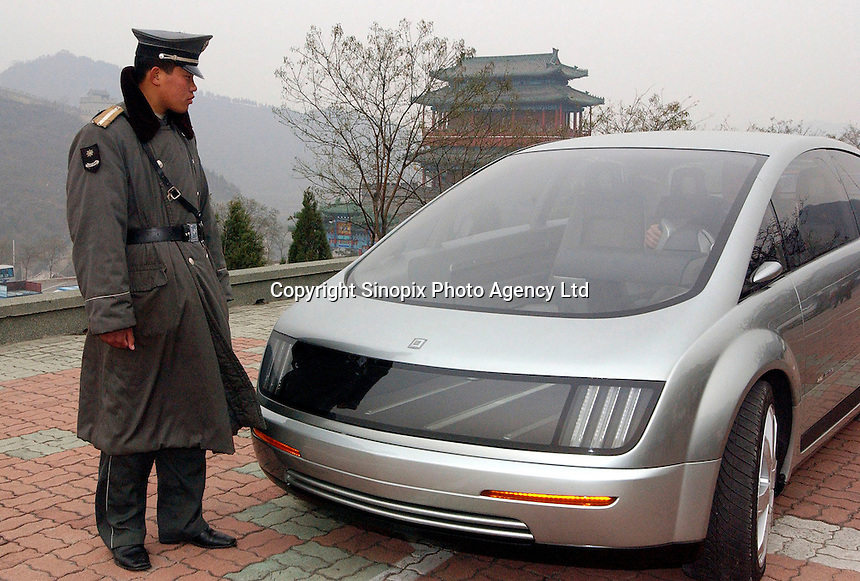 PLA stands next to the new GM Hy-Wire on the Great Wall, Beijing, China..