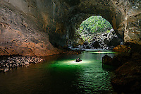Kayakers paddle out the upstream entrance of the Xe Bang Fai River Cave (Tham Khoun Xe) in Hin Nam No, Laos.