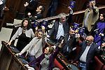 Rome March 10, 2015. Approvata alla Camera dei Deputati la riforma della Costituzione. nella foto: I deputati di SEL tengono alto in mano il testo della Costituzione durante la votazione.