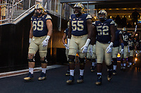 Pitt takes the field led by Adam Bisnowaty (69) Jaryd Jones-Smith (55) and Shakir Soto (52). The Pitt Panthers defeated the Marshall Thundering Herd 43-27 on October 1, 2016 at Heinz Field in Pittsburgh, Pennsylvania.