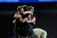 Oxford University players celebrate at the final whistle. The Varsity Match between Oxford University and Cambridge University on December 10, 2015 at Twickenham Stadium in London, England. Photo by: Patrick Khachfe / Onside Images