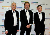 Jimmy Page, Robert Plant, and John Paul Jones of Led Zepplin arrive for the formal Artist's Dinner honoring the recipients of the 2012 Kennedy Center Honors hosted by United States Secretary of State Hillary Rodham Clinton at the U.S. Department of State in Washington, D.C. on Saturday, December 1, 2012. The 2012 honorees are Buddy Guy, actor Dustin Hoffman, late-night host David Letterman, dancer Natalia Makarova, and the British rock band Led Zeppelin (Robert Plant, Jimmy Page, and John Paul Jones)..Credit: Ron Sachs / CNP
