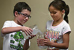 Parker Hale, 6, and Lillian Mendez, 7, help with an experiment during the Mad Science program at the Carson City Library, in Carson City, Nev., on Tuesday, July 15, 2014.<br />