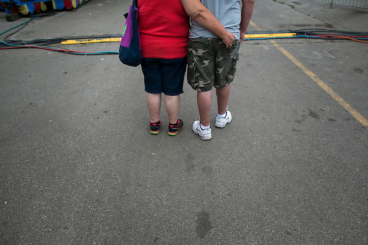 UNITED STATES - August 17: A couple watch the fair rides at the Iowa State Fair in Des Moines, Iowa, Monday, August 17, 2015. (Photo By Al Drago/CQ Roll Call)