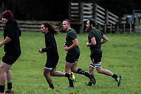 The Waitomo team warms up for the King Country rugby match between Waitomo and Piopio at Waitomo Rugby Club in Waitomo, New Zealand on Saturday, 14 July 2018. Photo: Dave Lintott / lintottphoto.co.nz