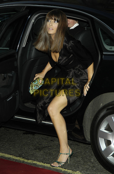 CLAUDIA WINKLEMAN.GQ Men of the Year Awards, Royal Opera House, London, 7th September 2004..full length getting out of car black dress fringe.Ref: PL.www.capitalpictures.com.sales@capitalpictures.com.©Capital Pictures.