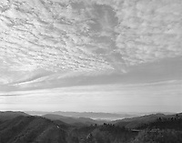 &quot;Morning Sky At Newfound Gap&quot; Great Smoky Mountains National Park, North Carolina<br /> <br /> I was driving at higher elevations in the Great Smoky Mountains National Park when the bottoms of clouds became illuminated by the low position of the early morning sun. I quickly exposed a black and white negative near the Newfound Gap parking lot on Highway 441 and the scene was captured nicely in this photo.