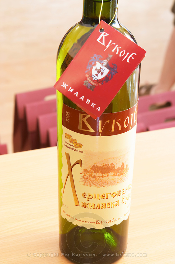 A bottle of Zilavka wine., in the winery tasting room. Vukoje winery, Trebinje. Republika Srpska. Bosnia Herzegovina, Europe.