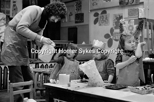 Chiswick Women's Aid, Chiswick London Uk 1975. Male playgroup member of staff Mike Taylor.