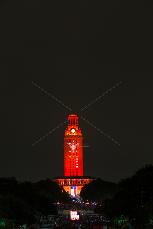 The University of Texas Graduation Ceremony paints the UT Tower draped in vibrant burnt orange during the 2017 Graduation Ceremony.