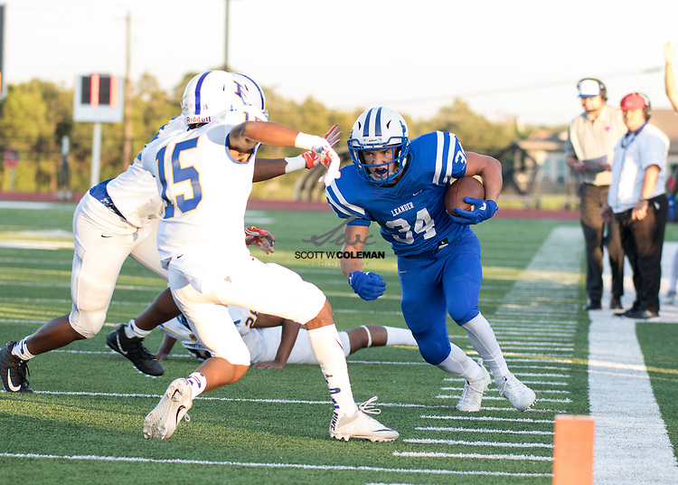 Leander Lions junior running back Adison LaRue (34) carries the ball during a high school football game between Leander and Pflugerville at Bible Stadium in Leander, Texas on Thursday, September 7, 2017.