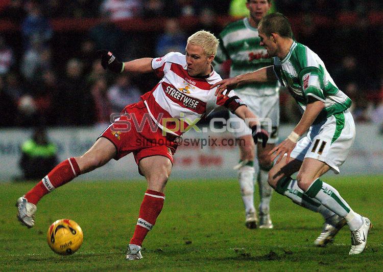 Pix: Howard Roe/SWpix.com. Football, Coca Cola League 1, Doncaster Rover v Yeovil Town 02/01/06..copyright picture>>simon wilkinson>>07811267706>>..Doncaster's Shaun Thornton challenged Yeovil's Nathan Jones