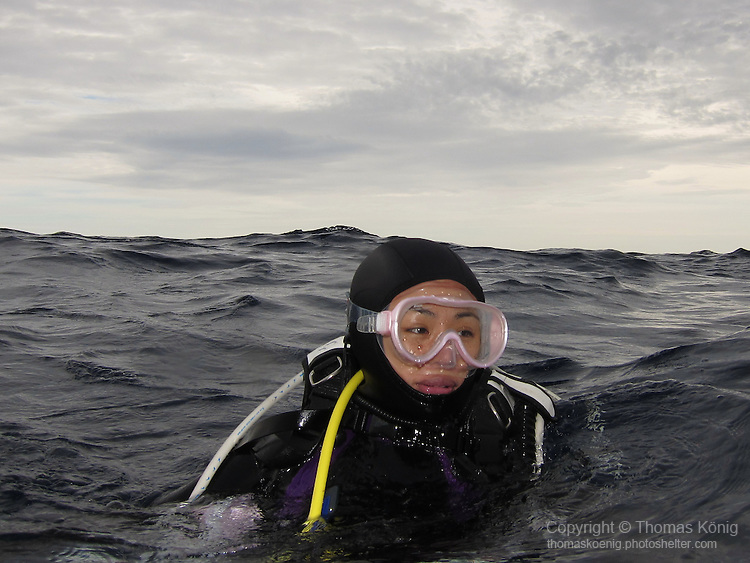 Qixingyan ('Seven Star Rock'), Taiwan -- Female diver after surfacing, waiting to be picked up by the dive boat.
