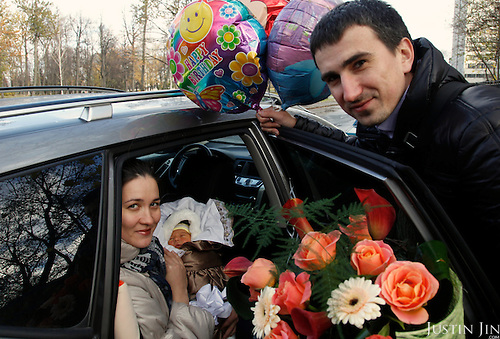 Parents with their new-born in St Petersburg.