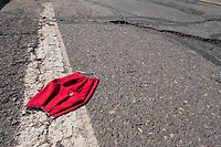A home-made surgical mask is seen laying in the street in Belmont, Massachusetts, on Sat., April 11, 2020. Discarded medical protective equipment (PPE) such as face masks and gloves are a common site during the ongoing Coronavirus (COVID-19) global pandemic.