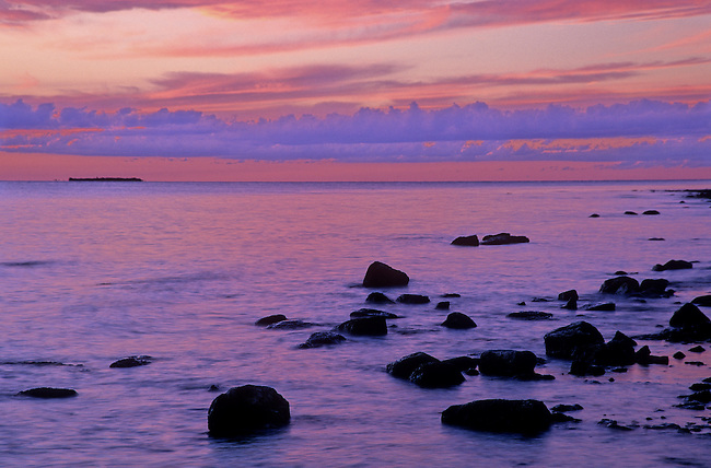 The sky glows magenta, red and purple after the sun has set under the Green Bay, Lake Michigan horizon, from the Peninsula State Park shore, Door County, Wisconsin.