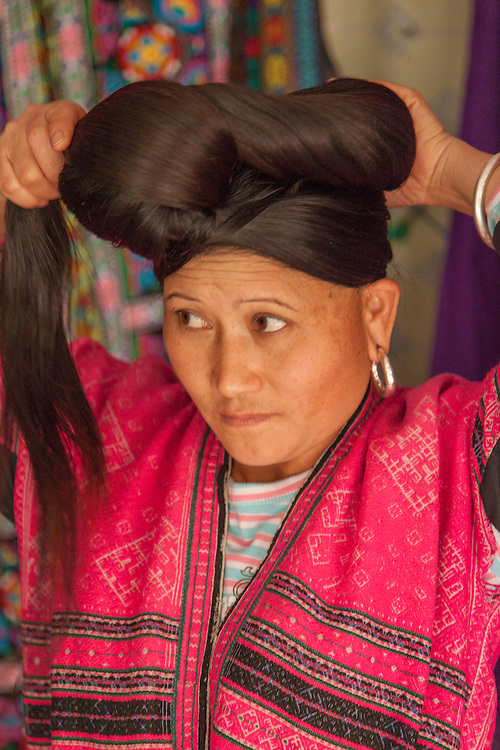 Yao women traditionally grow their hair until it reaches the ground and put it up into a heavy, turban shape  during their daily activities.