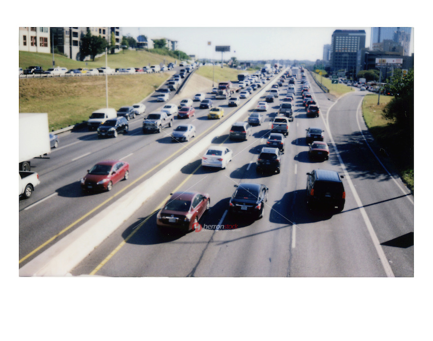 Fujifilm instax instant-film picture of IH-35 rush hour traffic in downtown Austin, Texas. Austin is often ranked the worst traffic in Texas - Stock Image.