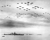 F4U's F6F's fly in formation during surrender ceremonies; Tokyo, Japan.  USS MISSOURI (in) left foreground.  September 2, 1945. (Navy)<br /> NARA FILE #:  080-G-421130<br /> WAR &amp; CONFLICT BOOK #:  1370