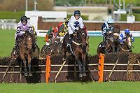 Touchthesoul middle ridden by Jamie Moore jumps the last first time around ahead of eventual winner Calva D'auge ridden by Harry Cobden left in The That Friday-Ad Feeling Maiden Hurdle during Horse Racing at Plumpton Racecourse on 4th November 2019