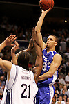 Kentucky forward Bobby Perry (13) puts up a shot over Connecticut defenders.  Connecticut defeated Kentucky 87-83 in the second round of the NCAA Tournament  at the Wachovia Center in Philadelphia, Pennsylvania on March 19, 2006.