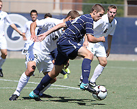 Steve Neumann #18 of Georgetown University pushes the ball away from Kevin Cope #3 of Michigan State during an NCAA match at North Kehoe Field, Georgetown University on September 5 2010 in Washington D.C. Georgetown won 4-0.