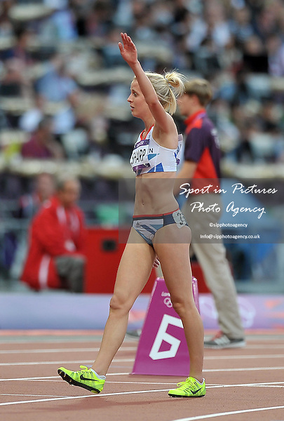 Britain's Lynsey Sharp waves as she leaves the track. Athletics - PHOTO: Mandatory by-line: Garry Bowden/SIP/Pinnacle - Photo Agency UK Tel: +44(0)1363 881025 - Mobile:0797 1270 681 - VAT Reg No: 768 6958 48 - 08/08/2012 - 2012 Olympics - Olympic Stadium, Olympic Park, London, England.