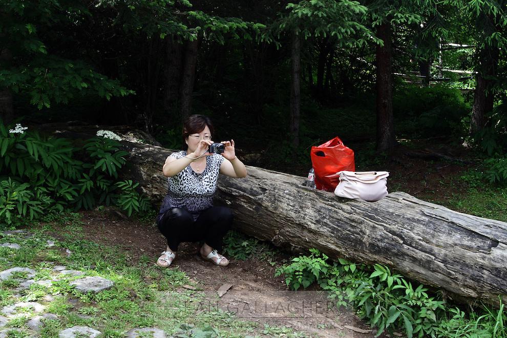 A tourist in the Jiuzhaigou National Park. Sichuan Province. China.