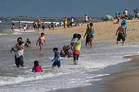 SANDY HOOK, NJ - JUNE 26: People visit the beach of Sandy Hook on June 26, 2020 in Sandy Hook, New Jersey. The State continue it's reopening while the U.S. hit record for new coronavirus cases. (Photo by Kena Betancur/ VIEWpress via Getty Images)