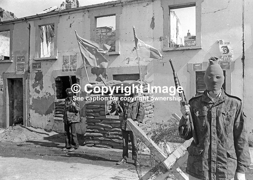 Provisional IRA members have set up a sandbag emplacement and checkpoint to regulate foot and vehicle traffic into and out of Free Derry, essentially the Bogside area of Londonderry. May 1972. 197205000294a<br /> <br /> Copyright Image from Victor Patterson, 54 Dorchester Park, Belfast, UK, BT9 6RJ<br /> <br /> Tel: +44 28 9066 1296<br /> Mob: +44 7802 353836<br /> Voicemail +44 20 8816 7153<br /> Email: victorpatterson@me.com<br /> Email: victorpatterson@gmail.com<br /> <br /> IMPORTANT: My Terms and Conditions of Business are at www.victorpatterson.com