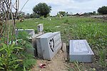 Headstones lay beside freshly disinterred graves at the Burr Oak Cemetery, one of the oldest and most historic black American cemeteries on the outskirts of Cook County, the same day four cemetery managers and caretakers were arrested on felony charges of disinterring and dismembering bodies at the cemetery in order to resell the plots to unsuspecting members of the public in Alsip, Illinois on July 9, 2009.