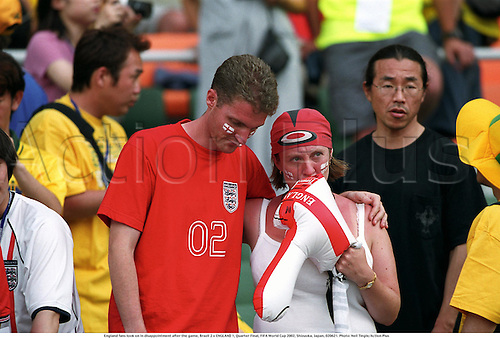 England fans look on in disappointment after the game, Brazil 2 v ENGLAND 1, Quarter Final, FIFA World Cup 2002, Shizuoka, Japan, 020621. Photo: Neil Tingle/Action Plus...association football.soccer.fans supporter supporters.despair despairs dissapointed.loss losing