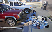 leaving0627 Daniel Diaz, 22 (CQ) front, sleeps on the ground outside a Utah gas station whle waiting for the station to open up after having car problems. (Pat Shannahan/ The Arizona Republic)