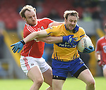 Brian O Driscoll of Cork in action against John Hayes of Clare during their National Football League game at Cusack Park. Photograph by John Kelly.