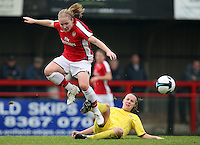 Kim Little of Arsenal skips the challenge of Jana Sedlackova - Arsenal Ladies vs Sparta Prague - UEFA Women's Champions League at Boreham Wood FC - 11/11/09 - MANDATORY CREDIT: Gavin Ellis/TGSPHOTO - Self billing applies where appropriate - Tel: 0845 094 6026