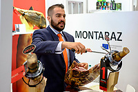NEW YORK, NY - JUNE 26: A man cuts Jamon Serrano at the Montaraz stand as he attends the Annual Summer Fancy Food Show at the Javits Center on June 26,2017. (Photo by Eduardo Munoz/VIEWpress/Corbis via Getty Images)