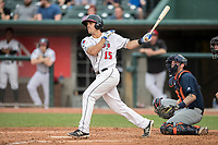 Lansing Lugnuts first baseman Nash Knight (15) follows through on his swing during the Midwest League baseball game against the Bowling Green Hot Rods on June 29, 2017 at Cooley Law School Stadium in Lansing, Michigan. Bowling Green defeated Lansing 11-9 in 10 innings. (Andrew Woolley/Four Seam Images)
