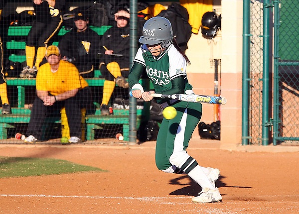 Denton, TX - FEBRUARY 16: Paige Kinsling #72 of University of North Texas mean green softball in action against the University of Iowa War Hawks at the Lovelace Field on February 16, 2013 in Denton, Texas. (Photo by Rick Yeatts)