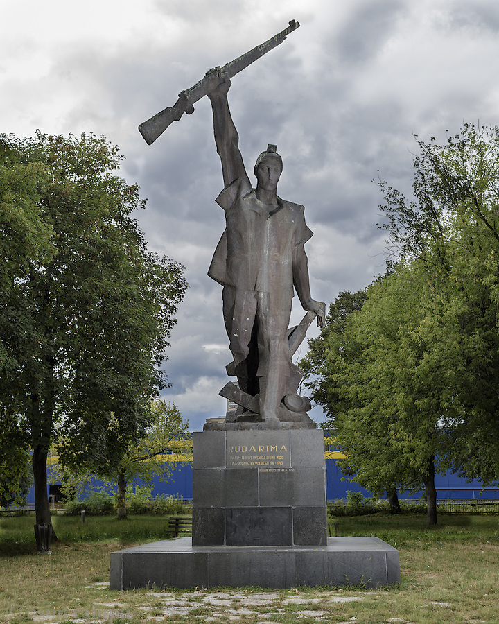 A statue that commemorates Husino rebellion of 1921 was a strike against poor working condition in coalfields, initiated by the colliers who were members of the leftist political organizations. Faced the well organised colliers the authorities, in order to break strike, employed colliers from Slovenia, who, as soon as they realized why they have been employed, rejected to work. In the following days, confronted with the authorities who neglected social discontent, planning to arrest strike leaders, and evict colliers from the colony, workers started armed rebellion, that was smothered seven days later, literary in blood of seven colliers, while 32 more of them were sentenced to death penalty.