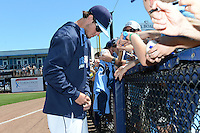 Tampa Bay Rays outfielder Wil Myers (9) signs autographs before a spring training game against the Minnesota Twins on March 2, 2014 at Charlotte Sports Park in Port Charlotte, Florida.  Tampa Bay defeated Minnesota 6-3.  (Mike Janes/Four Seam Images)