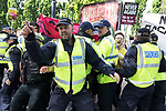 "© Joel Goodman - 07973 332324 . 11/06/2017 . Manchester , UK . Police separate anti fascists from the demonstration . Demonstration against Islamic hate , organised by former EDL leader Tommy Robinson's "" UK Against Hate "" and opposed by a counter demonstration of anti-fascist groups . UK Against Hate say their silent march from Piccadilly Train Station to a rally in Piccadilly Gardens in central Manchester is in response to a terrorist attack at an Ariana Grande concert in Manchester , and is on the anniversary of the gun massacre at the Pulse nightclub in Orlando . Photo credit : Joel Goodman"
