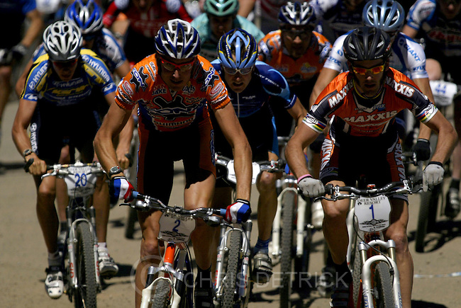"""Park City, UT--19 Jun 2005--.FROM LEFT: Todd Wells, #20, of Durango, CO., Ryan Trebon, #2,  of Corvallis, OR., and Geoff Kabush, #1, of Victoria BC.,   compete in the Pro Men's Short Track race at the 2005 Shimano NORBA Championship mountain bike series.  Wells, 21, was the eventual winner with a time of 21-minutes 38.8"""" seconds..**The NORBA men's and women's short track race at Deer Valley..Chris Detrick /Salt Lake Tribune.File #NORBA race CD 02"""